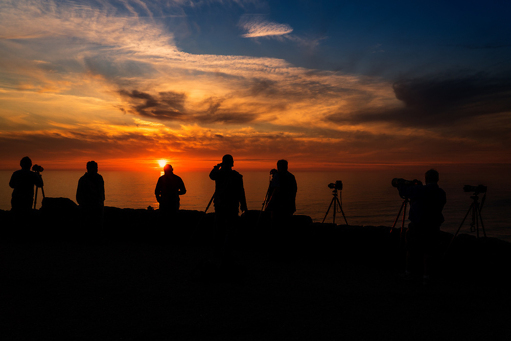 A collection of photographers enjoy the sunset over Oregon. Photo by Adel B. Korkor.