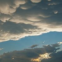 Cumulus thunderheads billow over Montana's Gallatin Valley at sunset,