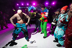 Yuroslav from Ukraine dancing (in 6 degree F/ -14.5 C weather) with Oksana Voevodina and friends on Lake Baikal with friends at the wrap party after the close of the Baikal Mile Ice Speed Festival. Maksimiha, Siberia, Russia. Saturday, February 29, 2020. Photography ©2020 Michael Lichter.