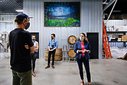 "22 JULY 2020 - AMES, IOWA: THERESA GREENFIELD (right) and ELLIOT THOMPSON, owner of Alluvial Brewing, talk about the needs of small businesses during a visit by Greenfield to Alluvial Brewing in Ames, IA. Greenfield, a Democrat, is running for the US Senate against incumbent Republican Senator Joni Ernst. Recent polls have Greenfield slightly ahead of or statistically tied with Ernst, who is closely allied with President Donald Trump. Although Greenfield is not doing much in person campaigning with big events, she is meeting with business people across the state of Iowa to promote her ""Small Towns, Bigger Paychecks"" economic program.       PHOTO BY JACK KURTZ"