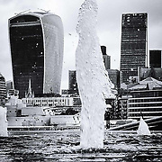 The tallest water fountain in London. <br /> <br /> Alternative view of the Walkie Talkie and Leadenhall Buildings. Shot on iPhone 6
