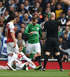 Referee Anthony Taylor awards a penalty for a foul by Brighton and Hove Albion's Alireza Jahanbakhsh on Arsenal's Nacho Monreal