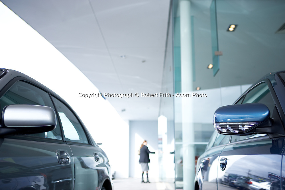 Anonymous looking new cars at a car dealership