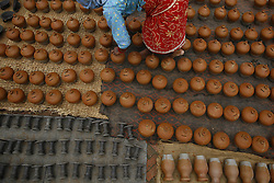 August 3, 2017 - Bhaktapur, Nepal - A woman arranges handmade clay pots at the ancient city of Bhaktapur in Nepal on Thursday. (Credit Image: © Skanda Gautam via ZUMA Wire)