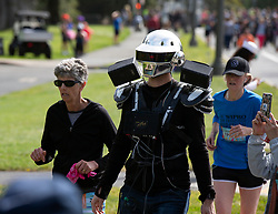 A man costumed as one half of the pop duo Daft Punk walks through Golden Gate Park at the 107th running of the Bay to Breakers, Sunday, May 20, 2018, in San Francisco. (Photo by D. Ross Cameron)