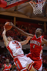 """31 January 2009: Sead Odzic takes it up strong against 7 footer David Collins.  Collins gets the ball clean, but gets called for a body foul. The Illinois State University Redbirds join the Bradley Braves in a tie for 2nd place in """"The Valley"""" with a 69-65 win on Doug Collins Court inside Redbird Arena on the campus of Illinois State University in Normal Illinois"""
