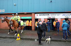 A heavy police presence outside Spotland Stadium, as away fans are searched before entering the ground - Mandatory byline: Matt McNulty/JMP - 06/12/2015 - Football - Spotland Stadium - Rochdale, England - Rochdale v Bury - FA Cup