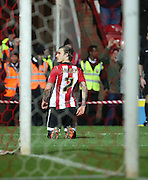 Brentford midfielder Sam Saunders celebrating scoring opening goal of game during the Sky Bet Championship match between Brentford and Leeds United at Griffin Park, London, England on 26 January 2016. Photo by Matthew Redman.