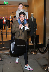 Adam Thomas with his son Teddy arriving for the opening of a French Connection shop in The Royal Exchange Shopping Arcade, Manchester on Wednesday evening
