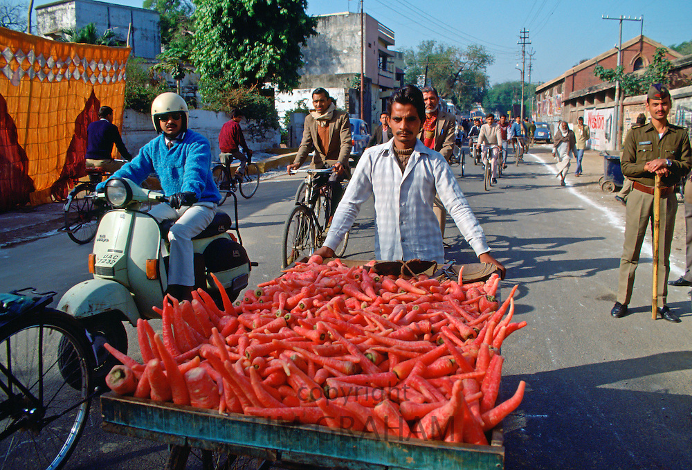 Transporting food to market  through the streets of Islamabad, Pakistan