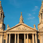 The golden light of late afternoon catches the front of St Paul's Cathedral, one of the most distinctive of London's landmarks. There has been a church on this site since 604 AD. The current building, with it's massive dome, was designed by Christopher Wren and dates back to the late 17th century.