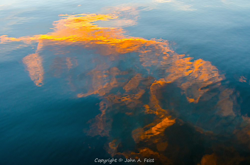 A reflection of the clouds and setting sun on the water in Red Bank, NJ.  I was out shooting for golden light and thought that the reflection was a better image than the cloud themselves.  How many horses can you find?