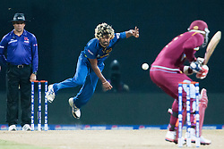© Licensed to London News Pictures. 29/09/2012. Sri Lankan Lasith Malinga bowling during the T20 Cricket World super 8's match between Sri Lanka Vs West Indies at the Pallekele International Stadium Cricket Stadium, Pallekele. Photo credit : Asanka Brendon Ratnayake/LNP
