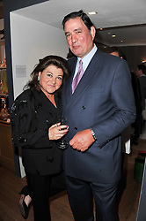 CARLO & LAURA DE CHAIR at a party to celebrate the publication of 'Garden' by Randle Siddeley held at Linley, 60 Pimlico Road, London on 24th May 2011.