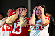 SAN FRANCISCO, CA - FEBRUARY 02: Jessica Rodriguez and her husband Tony Rodriguez of Concord, California react while watching the San Francisco 49ers play the Kansas City Chiefs during a Super Bowl LIV watch party at SPIN San Francisco on February 2, 2020 in San Francisco, California. The San Francisco 49ers faced the Kansas City Chiefs in Super Bowl LIV for their seventh appearance at the NFL championship, leading the game into half time and losing after 21 unanswered points in the second half of the game. (Photo by Philip Pacheco/Getty Images)