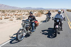 Ben Brown (L), Vinnie Grisser and Steve Decosa ride their Harley-Davidson motorcycles through the California desert during the Motorcycle Cannonball Race of the Century. Stage-14 ride from Lake Havasu CIty, AZ to Palm Desert, CA. USA. Saturday September 24, 2016. Photography ©2016 Michael Lichter.