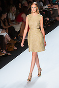 Yellow brocade sleeveless dress. By Monique Lhuillier at Spring 2013 Fall Fashion Week in New York.