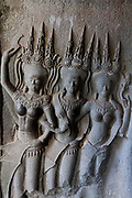 Angkor Wat, Siem Riep. Angkor Wat is a huge temple complex,most of it build almost one thousand years ago. The area spans 10 square Km and is one of Cambodia's biggest tourist attractions. spans 10 square Km and is one of Cambodia's biggest tourist attractions. Stone carvings of Hindu Devatas, devine guardians.