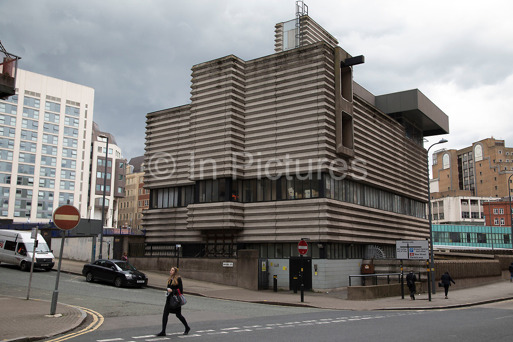 Brutalist concrete architecture of New Street Station Signal Box in Birmingham, United Kingdom. New Street Stationhas been at the centre of public attention in recent times, with itsextensive redevelopment works in full swing. However, at the heart of it, and often overlooked, sits the Grade II listed signal box on Navigation Street, which houses the centre of all rail operations of the station. The corrugated concrete Brutalist structure may polarise public opinion, but is actually home of one of the city's most vital and intense infrastructure systems, serving the busiest rail interchange in the UK. Brutalist architecture is a movement in architecture that flourished from the 1950s to the mid-1970s, descending from the modernist architectural movement of the early 20th century.