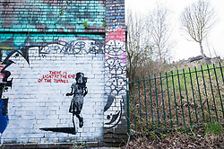 "© Licensed to London News Pictures; 14/03/2021; Bristol, UK. A mural in the style of Banksy with an image of a girl and with the words ""There is light at the end of the tunnel"", is seen next to a tunnel under the railway off Muller Road in Bristol. According to some locals it has been painted very recently, perhaps early this morning. Banksy often comments on current events, and if the piece is by Banksy it could be a reference to the end of the covid-19 coronavirus pandemic, or to social movements such as #MeToo, Black Lives Matter, or Reclaim the Streets. Photo credit: Simon Chapman/LNP."