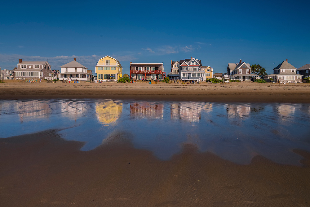Summer cottages reflected in out wash. Wells Beach, ME