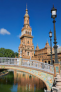 The North Tower of the Plaza de Espana in Seville built in 1928 for the Ibero-American Exposition of 1929, Seville Spain . The Royal Alcázars of Seville (al-Qasr al-Muriq ) or Alcázar of Seville, is a royal palace in Seville, Spain. It was built by Castilian Christians on the site of an Abbadid Muslim alcazar, or residential fortress.The fortress was destroyed after the Christian conquest of Seville The palace is a preeminent example of Mudéjar architecture in the Iberian Peninsula but features Gothic, Renaissance and Romanesque design elements from previous stages of construction. The upper storeys of the Alcázar are still occupied by the royal family when they are in Seville. <br /> <br /> Visit our SPAIN HISTORIC PLACES PHOTO COLLECTIONS for more photos to download or buy as wall art prints https://funkystock.photoshelter.com/gallery-collection/Pictures-Images-of-Spain-Spanish-Historical-Archaeology-Sites-Museum-Antiquities/C0000EUVhLC3Nbgw <br /> .<br /> Visit our MEDIEVAL PHOTO COLLECTIONS for more   photos  to download or buy as prints https://funkystock.photoshelter.com/gallery-collection/Medieval-Middle-Ages-Historic-Places-Arcaeological-Sites-Pictures-Images-of/C0000B5ZA54_WD0s