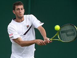 23.06.2011, Wimbledon, London, GBR, Wimbledon Tennis Championships, im Bild James Ward (GBR) in action during the Gentlemen's Doubles 1st Round match on day four of the Wimbledon Lawn Tennis Championships at the All England Lawn Tennis and Croquet Club, EXPA Pictures © 2011, PhotoCredit: EXPA/ Propaganda/ *** ATTENTION *** UK OUT!