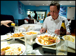 Leader of the Conservative Party David Cameron having a curry in Witney on a Friday night during the general election campaign, Friday April 30, 2010. Photo By Andrew Parsons / i-Images.