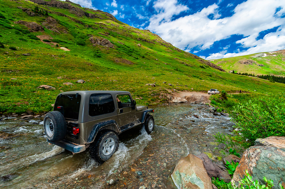 Four wheel drive vehicles crossing a stream, American Basin, San Juan Mountains (range of the Rocky Mountains), Southwest Colorado USA