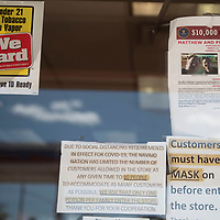 A flyer of the Reagan brothers hangs on the door of the Sawmill Express Store in Sawmill, Arizona seeking information leading to the arrest and conviction of the person or people responsible for their deaths. The bodies of brothers Matthew Reagan and Philip Reagan were found shot to death about 2.5 miles west of the Sawmill Express Store on Navajo Route 7 in March of last year.