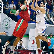 Anadolu Efes's Dogus BALBAY (R) during their Turkey Cup Qualifying basketball second match Anadolu Efes between Pinar Karsiyaka at Aliaga Arena in Izmir, Turkey, Monday, October 10, 2011. Photo by TURKPIX