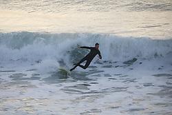 May 6, 2019 - Christchurch, New Zealand - A surfer loses his balance as he rides a wave at New Brighton Beach in Christchurch, New Zealand on May 05, 2019. (Credit Image: © Sanka Vidanagama/NurPhoto via ZUMA Press)