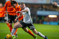 Dundee United's Ian Harkes and Ayr United's Stephen Kelly. half time : Dundee United 1 v 0 Ayr United, Scottish Championship game played 21/12/2019 at Dundee United's stadium Tannadice Park.