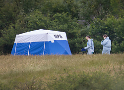 © Licensed to London News Pictures. 08/06/2020. London, UK. Police forensics officers walk past an evidence tent at Fryent Country Park near Wembley, north London. According to reports, two women were found unresponsive and were pronounced dead at the scene yesterday. Photo credit: Peter Macdiarmid/LNP