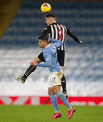 Ciaran Clark of Newcastle United (Top) in action - Mandatory by-line: Jack Phillips/JMP - 26/12/2020 - FOOTBALL - Etihad Stadium - Manchester, England - Manchester City v Newcastle United - English Premier League