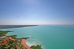 Pindan soil and mangroves meet aqua water on the shores of Roebuck Bay in Broome.