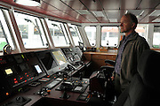 © Licensed to London News Pictures. 08/11/2011. London, UK. Joel Stewart, the captain of the Greenpeace flagship, Rainbow Warrior in South Quay in London's Docklands today 8th November 2011, after making her maiden voyage from Amsterdam. It is the first Greenpeace ship to have been specifically built, the previous two being refits. Photo credit : Stephen Simpson/LNP