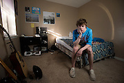 Christian Akridge poses for a portrait in his room in Wichita Falls, Texas on November 18, 2015.  (Cooper Neill for Rolling Stone)