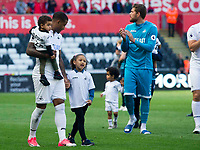 Football - 2016 / 2017 Premier League - Swansea City vs. West Bromwich Albion<br /> <br /> Luciana Narsingh of Swansea with children after Swansea win the game, at Liberty Stadium.<br /> <br /> COLORSPORT/WINSTON BYNORTH