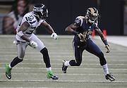 Football - NFL- Seattle Seahawks at St. Louis Rams.St. Louis Rams wide receiver Chris Givens (13) runs past Seattle Seahawks cornerback Brandon Browner (39) during a play in the third quarter at the Edward Jones Dome in St. Louis.  The Rams defeated the Seahawks, 19-13.