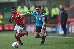 Charlton Athletic's Nicky Ajose and Fleetwood Town's Lewie Coyle battle for the ball