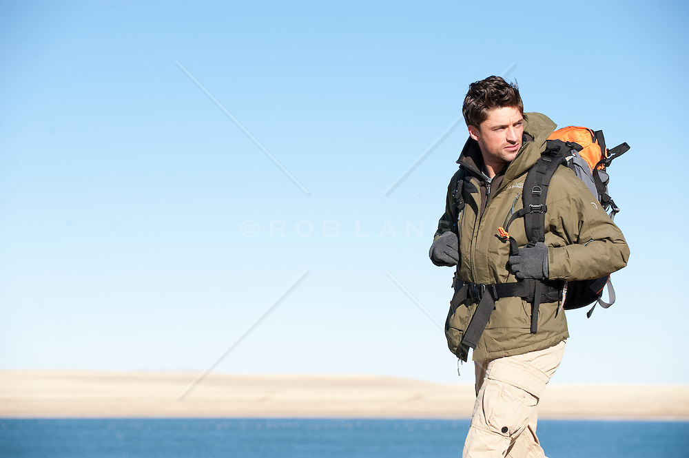 Outdoorsman hiking near a high desert lake in New Mexico