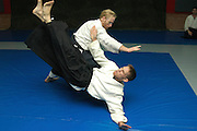 Two men in an Aikido contact sport competition