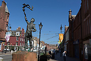 """The statue by Ukranian artist Valentin Znoba, of the Scots-born American environmentalist, John Muir in Dunbar High Street, on 27th June 2019, in Dunbar, East Lothian, Scotland. John Muir (1838–1914) also known as """"John of the Mountains"""" and """"Father of the National Parks"""" was an influential Scottish-American naturalist, author, environmental philosopher, glaciologist, and early advocate for the preservation of wilderness in the United States of America but spent his childhood in Dunbar until emigrating to America at the age of 11."""
