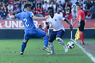 Arvin Appiah of England takes on Alberto Barazzetta of Italy (2) during the UEFA European Under 17 Championship 2018 match between England and Italy at the Banks's Stadium, Walsall, England on 7 May 2018. Picture by Mick Haynes.