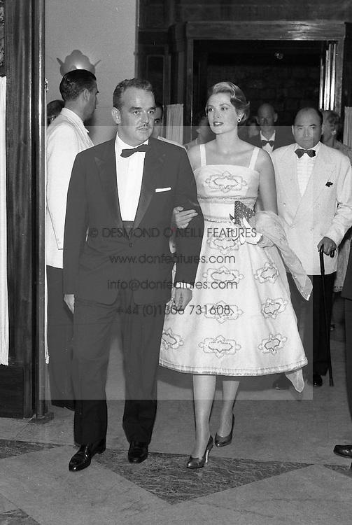 PRINCE RAINIER & PRINCESS GRACE OF MONACO arrive at the Bal de La Mer, Monte Carlo, Monaco in 1958.
