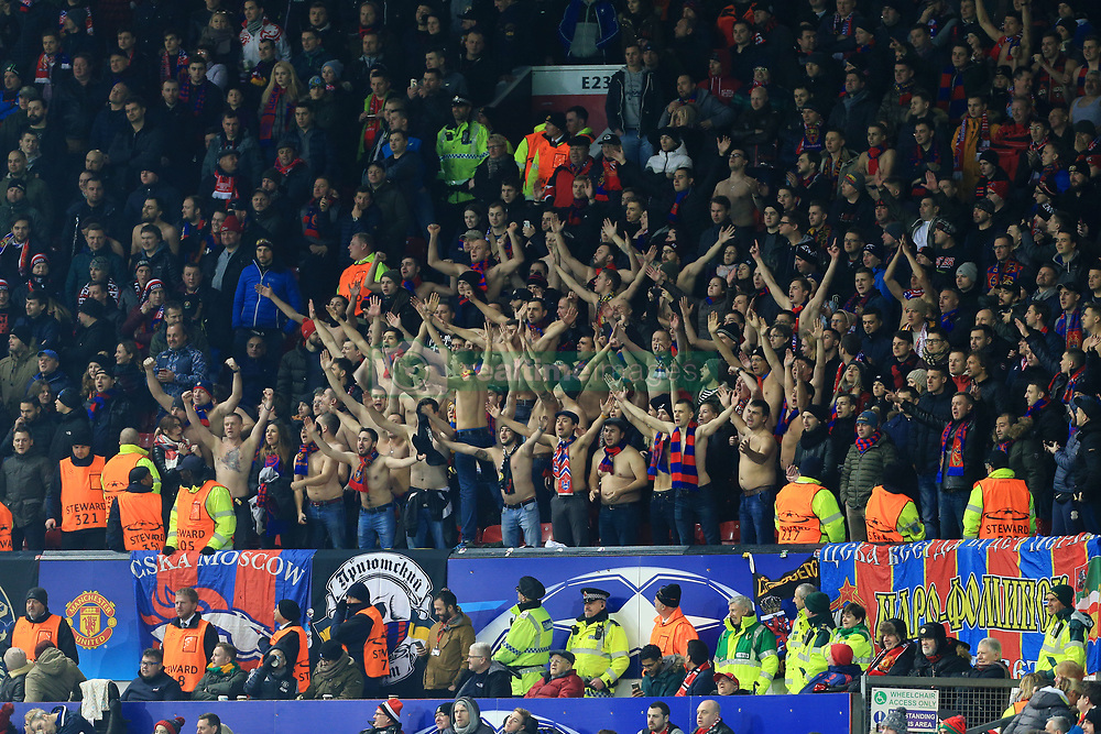 5th December 2017 - UEFA Champions League - Group A - Manchester United v CSKA Moscow - CSKA fans remove their shirts and show their support topless - Photo: Simon Stacpoole / Offside.