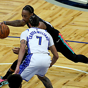ORLANDO, FL - APRIL 12: DeMar DeRozan #10 of the San Antonio Spurs dribbles the ball as Michael Carter-Williams #7 of the Orlando Magic defends during the first half at Amway Center on April 12, 2021 in Orlando, Florida. NOTE TO USER: User expressly acknowledges and agrees that, by downloading and or using this photograph, User is consenting to the terms and conditions of the Getty Images License Agreement. (Photo by Alex Menendez/Getty Images)*** Local Caption *** DeMar DeRozan; Michael Carter-Williams