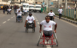 November 29, 2016 - Gaza City, Gaza Strip, Palestinian Territory - Palestinian men on wheelchairs to compete in a marathon organized for the Palestinians who have been wounded as a result of wars, in the November 29, 2016 in Gaza City. Tens of thousands of Gaza residents are learning to cope with disability or lost parties after the three wars between the Palestinian militants in the territories and Israel since 2008  (Credit Image: © Ashraf Amra/APA Images via ZUMA Wire)