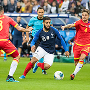 PARIS, FRANCE - September 10:  Nabil Fekir #18 of France dribbles between Marc Rebés #4 of Andorra and Marc Vales #3 of Andorra  during the France V Andorra, UEFA European Championship 2020 Qualifying match at Stade de France on September 10th 2019 in Paris, France (Photo by Tim Clayton/Corbis via Getty Images)